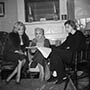 Original caption: 2/5/59-Nyack, New York:  Actress Marilyn Monroe (left) watches as famed Danish author Isak Dinesen examines a manuscript at the home of U.S. writer Carson McCullers here, Feb. 5th.  The occasion was a luncheon given by Miss McCullers in honor ofthe Danish writer, whose real name is the baroness Karen Blixen.  Miss Dinesen is currently on a lecture tour ofthe U.S.  Marilyn was on hand for the affair with husband Arthur Miller. Nyack, New York, USA